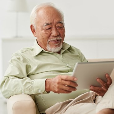 A man reading a tablet.