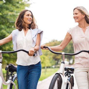Two women riding bikes.